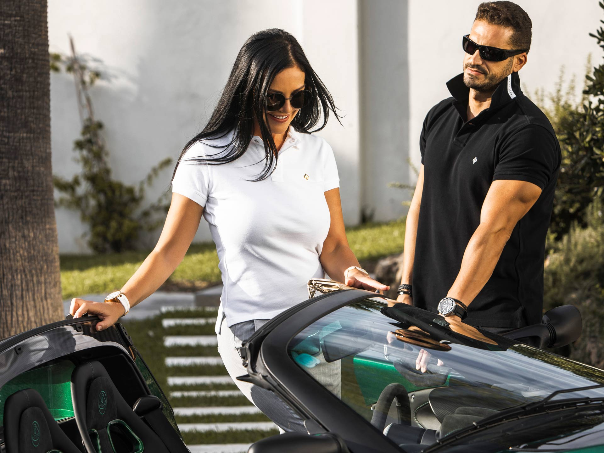 Natasha Romanov and Magna Cars with their Limited Edition Ace of Aces polo shirts